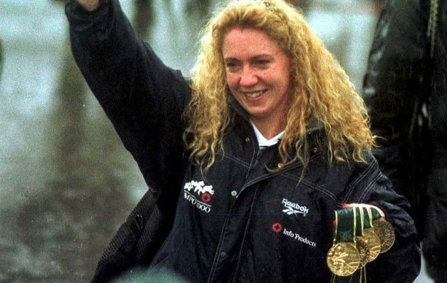 Irish Olympic Swimmer Michelle Smith returns home to Ireland with her four Olympic medals in1996.