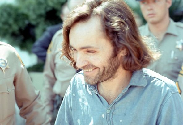 American criminal and cult leader Charles Manson (1934 - 2017) is escorted by Los Angeles County sheriffs to a police van to the Santa Monica Courthouse to appear in court for a hearing regarding the murder of music teacher Gary Hinman, Los Angeles, California, June 25, 1970.