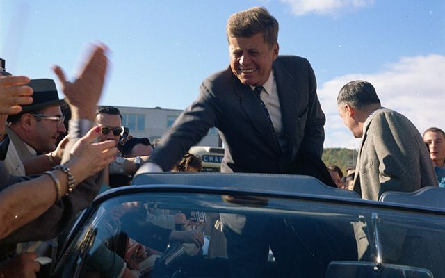 During a campaign trip, Senator John F. Kennedy greets a roadside crowd in Indiana.\n