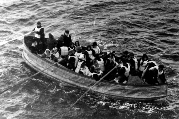 This photograph was taken by a passenger of the Carpathia, the ship that received the Titanic\'s distress signal and came to rescue the survivors. It shows the last lifeboat successfully launched from the Titanic.
