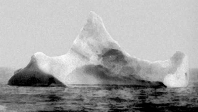 "The iceberg suspected of having sunk the RMS Titanic. This iceberg was photographed by the chief steward of the liner Prinz Adalbert on the morning of April 15, 1912, just a few miles south of where the ""Titanic"" went down. The steward hadn\'t yet heard about the Titanic. What caught his attention was the smear of red paint along the base of the berg, indication that it had collided with a ship sometime in the previous twelve hours. This photo and information was taken from \""UNSINKABLE\"" The Full Story of RMS Titanic written by Daniel Allen Butler, Stackpole Books 1998. Other accounts indicated that there were several icebergs in the vicinity where the TITANIC collided."