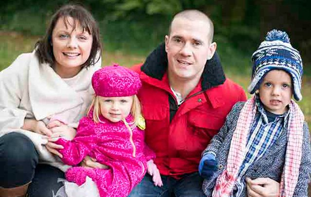 Form Irish Voice reporter April Drew with her husband John Mooney and Sadie (2) and Colum (4).