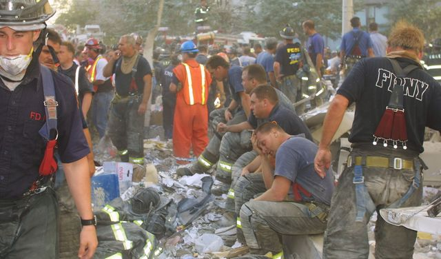 Exhausted 9/11 first responders at Ground Zero on Sept 11 2001, at the World Trade Center.