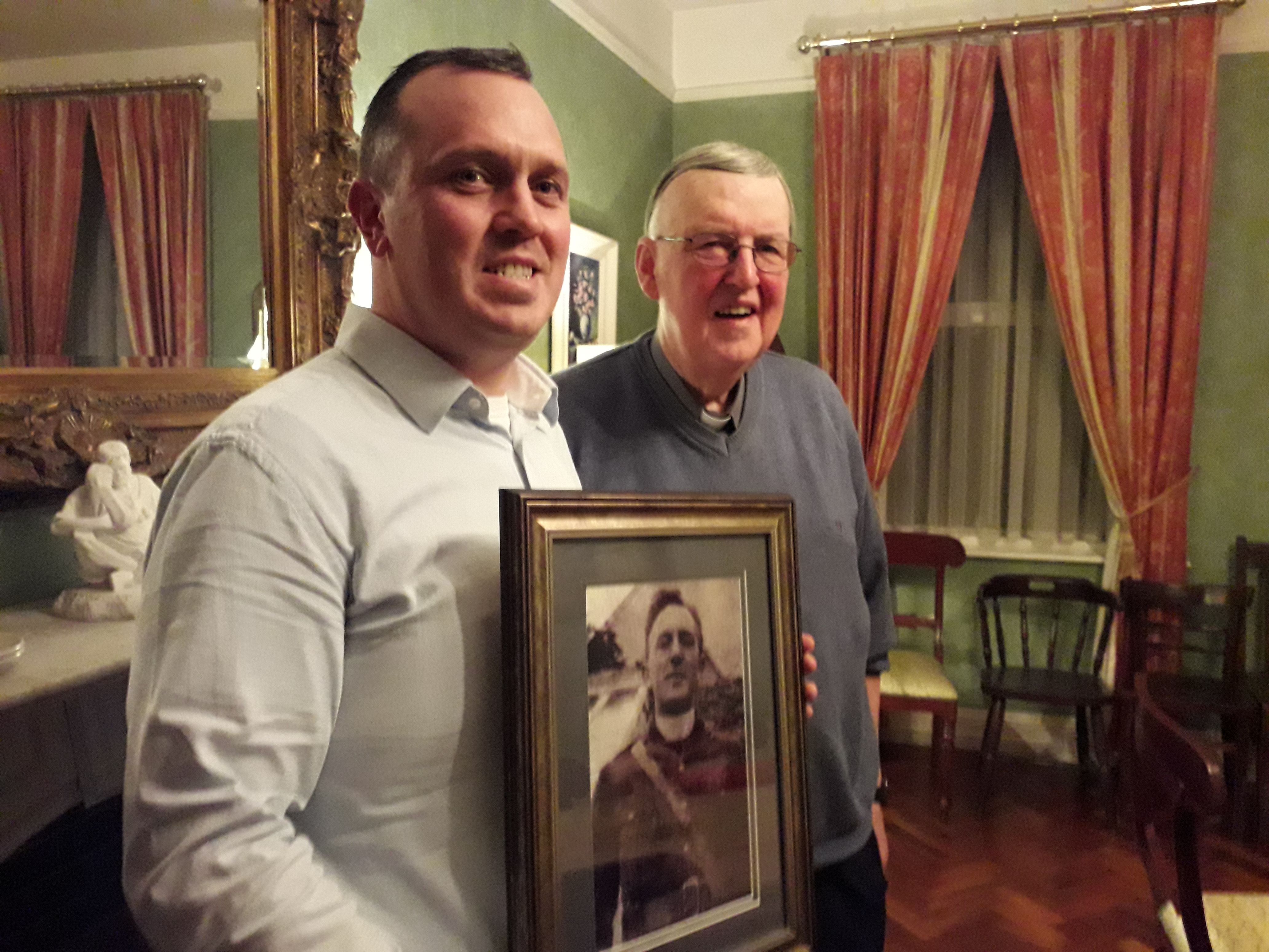 John Connolly and Fr Martin Downey, with a photo of Fr Griffin, courtesy of Ciaran Tierney Digital Storyteller.