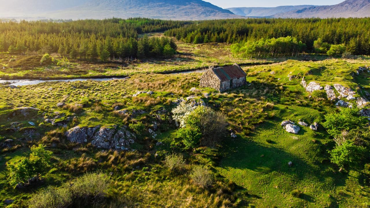 An old cottage along a river in Connacht