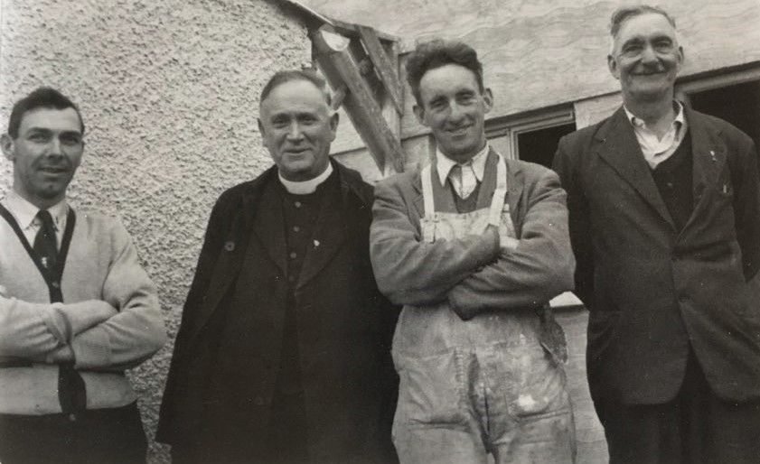 Canon Hayes checking out new houses under construction in Bansha, Co. Tipperary, with Eddie McCarthy, Mikey Morrissey and Ned Hanly.