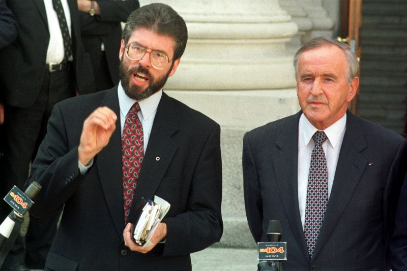 Sinn Fein President Gerry Adams and Taoiseach and leader of Fianna Fail, Albert Reynolds on the steps of Government Buildings in Dublin, during the historic meeting between them and John Hume, Leader of the SDLP, which is generally regarded as the first offical step of the Peace Process in Northern Ireland. 1994. (Photo: Eamonn Farrell/RollingNews.ie)