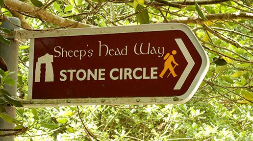 Ahakista Stone Circle signpost on Sheep' Head Way trail.