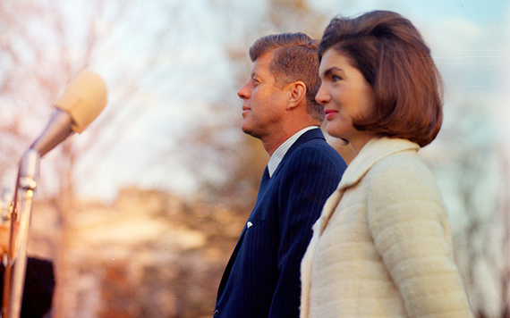 President John F. Kennedy and First Lady Jacqueline Kennedy stand on the South Lawn before the performance of the Black Watch (Royal Highland Regiment), White House, Washington, D.C. Cecil Stoughton. White House Photographs. John F. Kennedy Presidential Library and Museum.