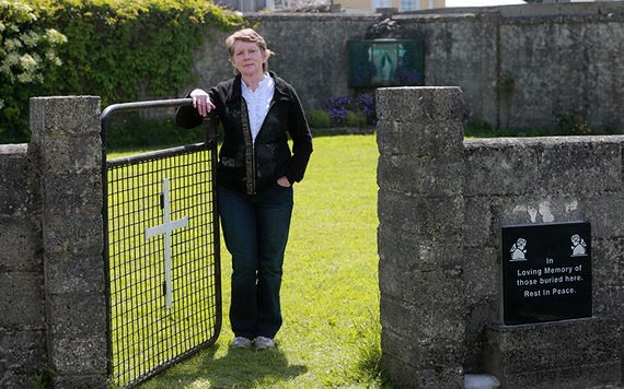 Catherine Corless standing infront of the plot where 796 babies were buried in a mass grave.