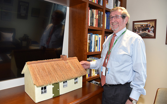 Michael Dowling with the replica of his childhood home that he constructed.  (Photo:Nuala Purcell.)