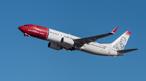 Norwegian Air plane on take off. Image: WikiCommons / Julian Herzong.