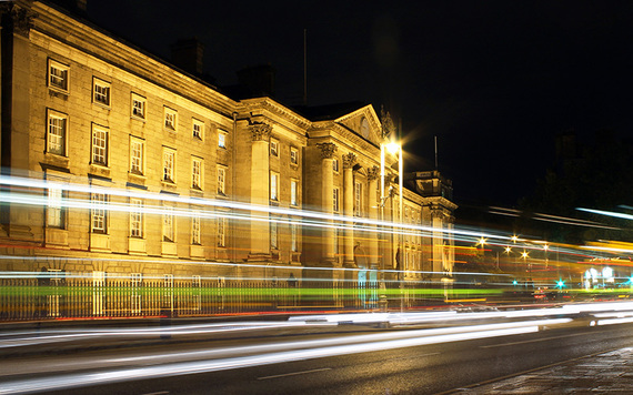Trinity College and College Green by night.