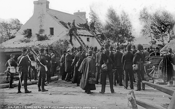 Constables surround the home of boatbuilder Francis Tully on land owned by the Marquis of Clanricarde at Woodford, County Galway. IMAGE: NATIONAL LIBRARY OF IRELAND