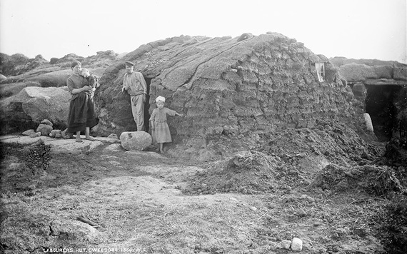 A laborer's family outside their temporary turf hut after being evicted from their home. IMAGE: NATIONAL LIBRARY OF IRELAND