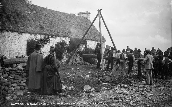 A battering ram is used to breach a farmer's home. IMAGE: NATIONAL LIBRARY OF IRELAND